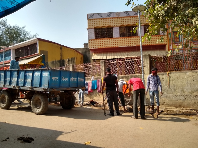 Nagar Nigam workers cleaning the debris from the roads.