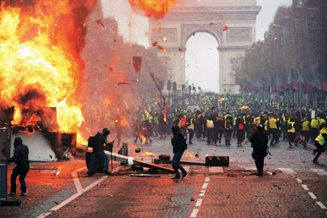 Paris Witnesses The Worst Riots In A Decade Following Violent 'Yellow Jacket' Protests Against Rising Fuel Taxes