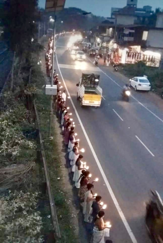 Thousands of devotees lining up near a highway to participate in the Ayyappa Jyoti programme