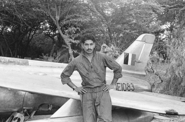 PAF Flight Lieutenant Hatmi stands beside the Gnat of the IAF captured in Pasrur.