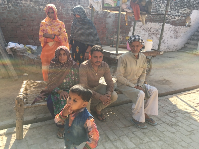 Akhtar Ali (right) with his family in Badarkha village on 14 March. On his left is his son Irshad (Kavi). The woman on the left is Ali's wife.