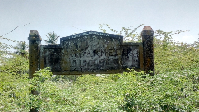 The blackened signage at the site where Kambar was born.