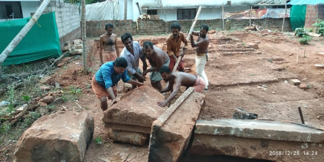 Old foundation stones of the temple being mobilised for restoration.