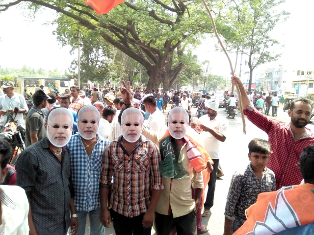 Supporters celebrate the victory of the BJP in the state and country.