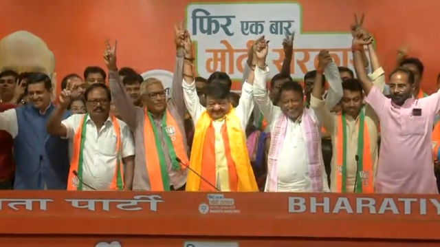 Trinamool leaders joining the BJP in the party headquarters.