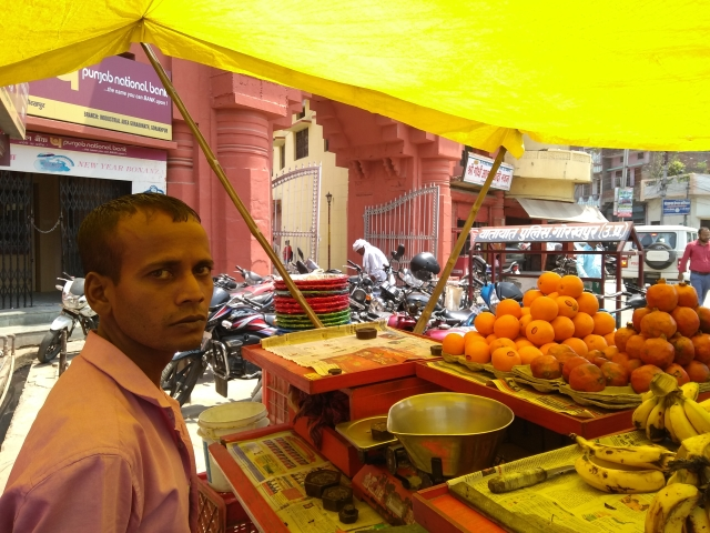 Satish Sonkar's fruit stall just outside the temple. (Prakhar Gupta/Swarajya)