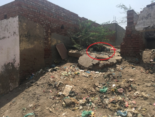 The garbage dump located right outside Jahid's house and a few metres from Aslam's