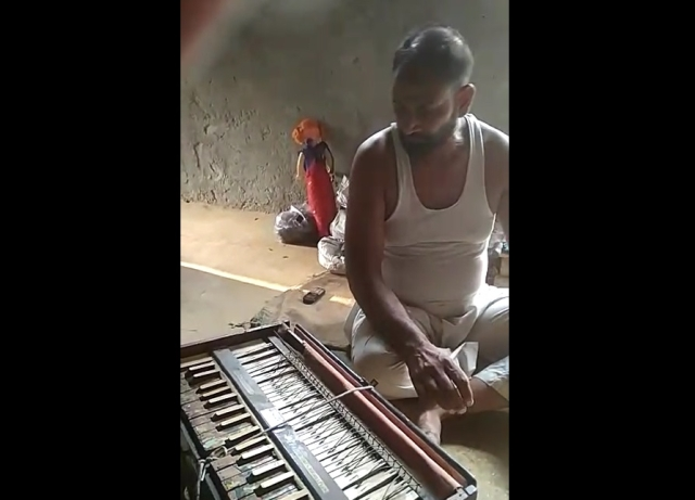 Dilsher Khan with his damaged harmonium.