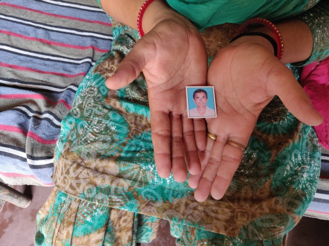 Kiranbala holds the photo of her late husband, Inderpal Bishnoi.