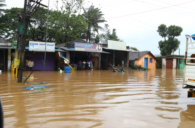 Houses and shops inundated in Sakleshpura.