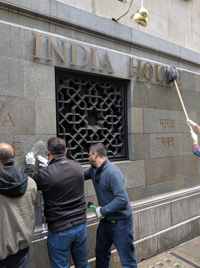 Indian volunteers cleaning the high commission's walls