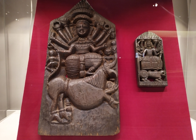 Wooden plaques dated 18th Century (left) and late 19th Century depicting Mahishasuravadh.