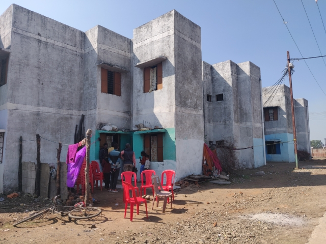 A view of Dhan Prasad's house, where red chairs are placed. (Swati Goel Sharma/Swarajya Magazine)