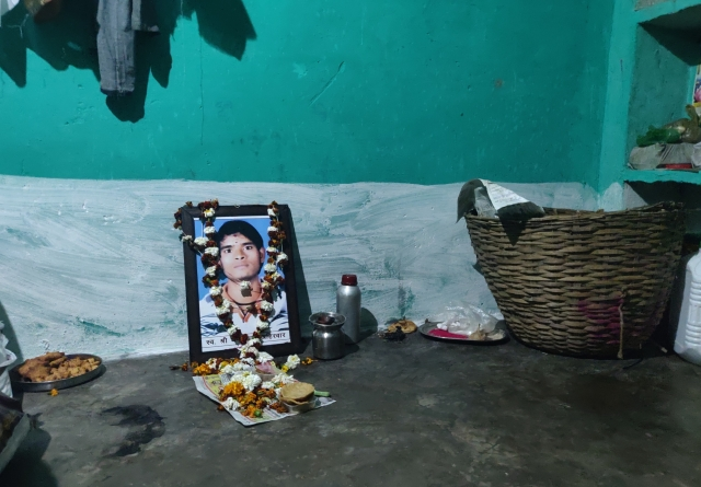 Dhan Prasad Ahirwar's picture in the room where he was allegedly set afire by neighbours. (Swati Goel Sharma/Swarajya Magazine)