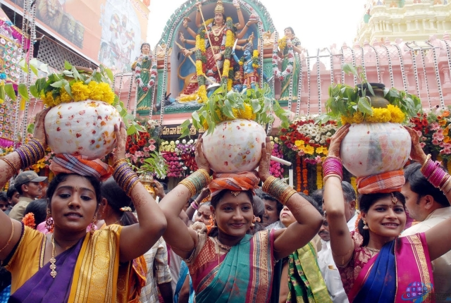 Women carrying the Bonams to be offered to the Goddess