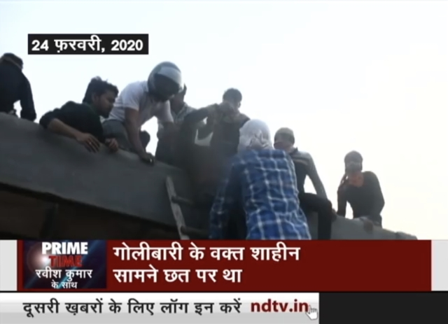 Screen grab from <i>NDTV Prime Show</i>, 5 March 2020 which shows Shahid Alam being brought down from roof by ladder.