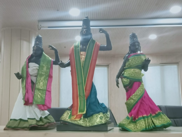 The idols dressed in traditional attire.