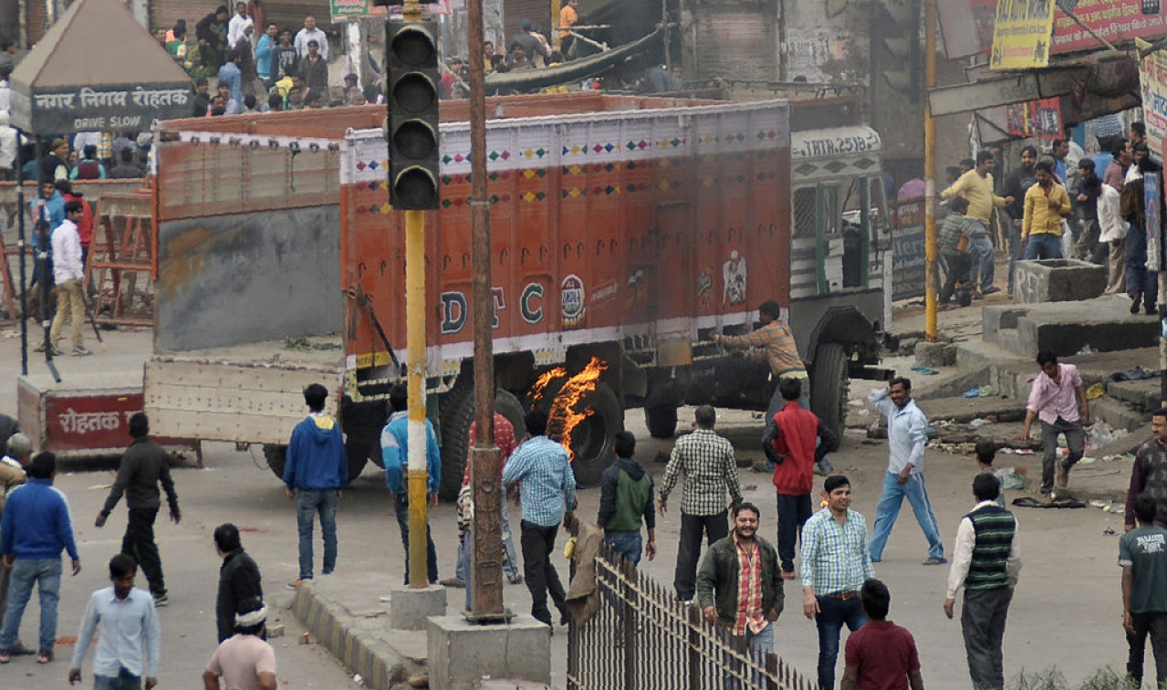 Jat protesters burning a truck (Getty Images)