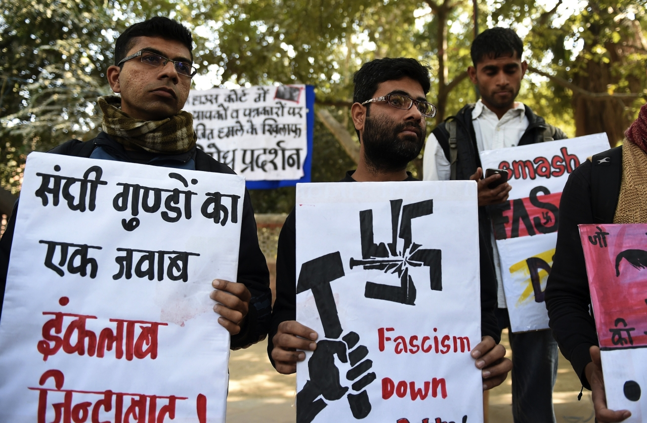 Indian activists of the DISHA Students Organistion hold placards against the February 15, 2016 attack on JNU students and teachers at Patiala House court, during a protest in New Delhi on February 16, 2016. Indian students,teachers and activists are protesting against the arrest of a top university student leader after he was charged with sedition, and demanding his immediate release. AFP PHOTO / Prakash SINGH / AFP / PRAKASH SINGH        (Photo credit should read PRAKASH SINGH/AFP/Getty Images)