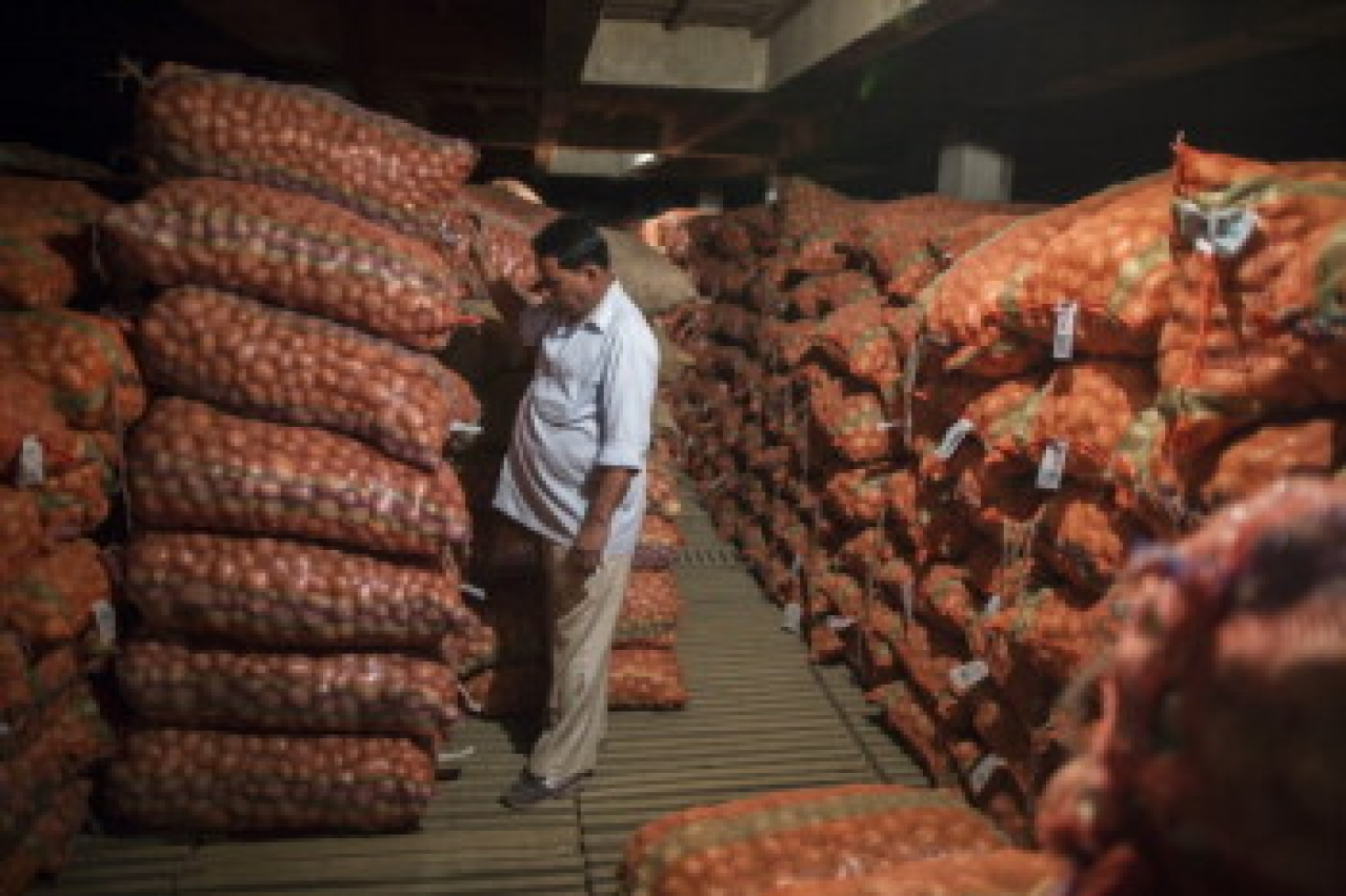 A supervisor inspects sacks of potatoes stacked inside a cold storage unit at the Fryo Foods Pvt factory in Meerut, Uttar Pradesh. (Prashanth Vishwanathan/Bloomberg via Getty Images)