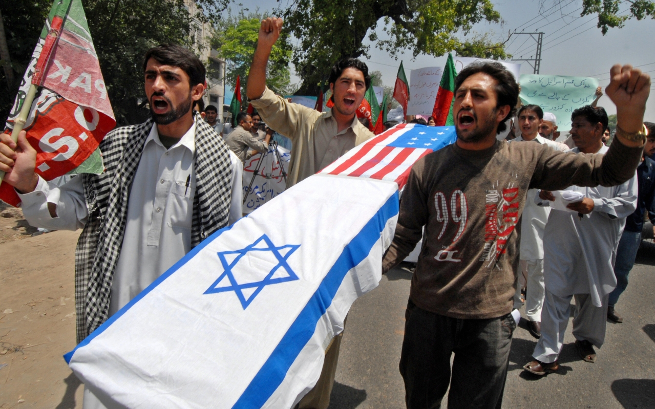 Pakistani Shiite Muslim protesters carry a coffin wrapped in US and Israeli flags during a protest in Peshawar on May 16, 2008 to mark the 60th anniversary of the Jewish state. Al-Qaeda chief Osama bin Laden slammed Western leaders for taking part in Israel's 60th birthday celebrations and vowed that Muslims would not give up 'one inch of Palestine,' in an audio message. AFP PHOTO/Tariq MAHMOOD (Photo credit: TARIQ MAHMOOD/AFP/Getty Images)
