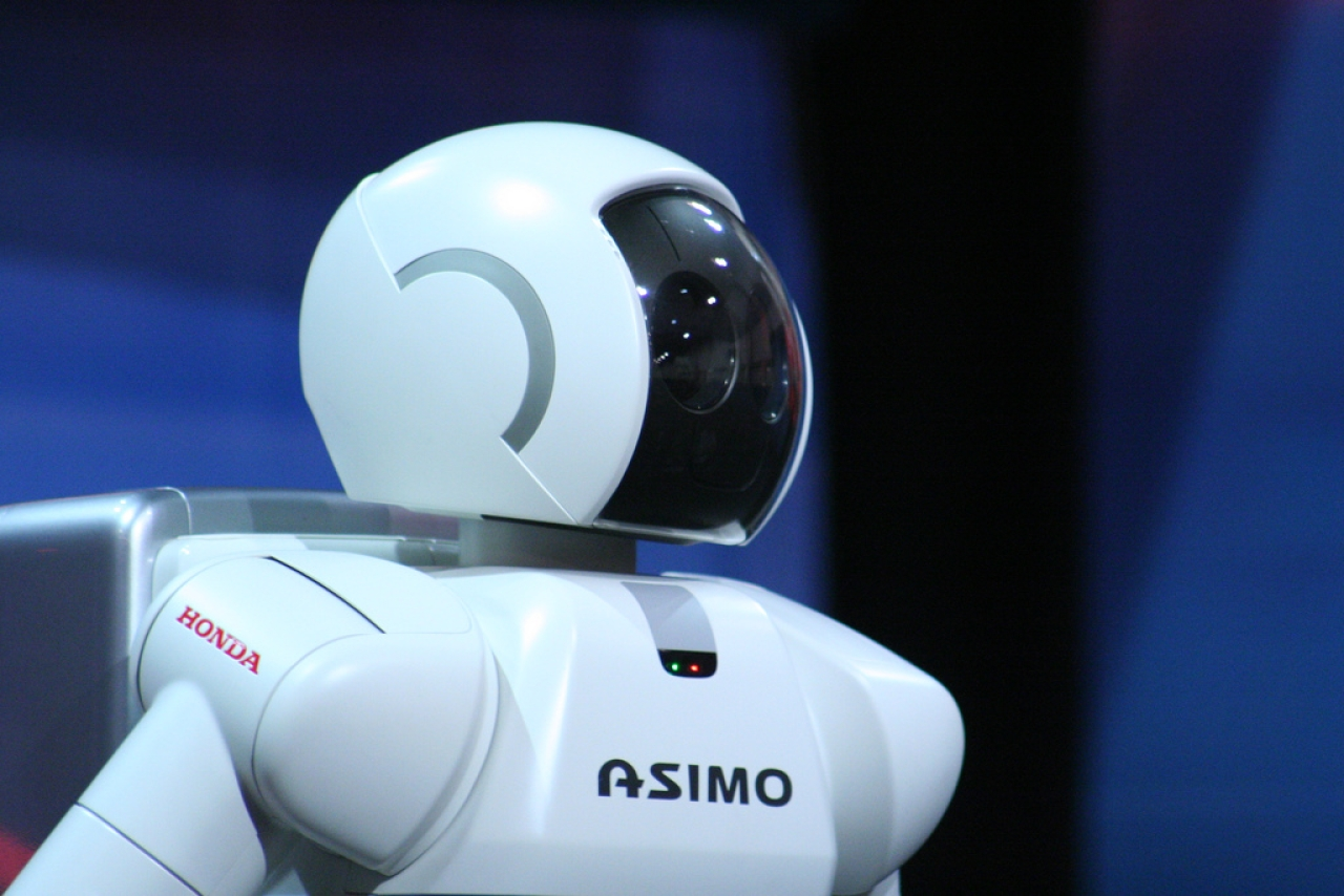 Asimo Robot, the man-made machine with a maiden name. He has a head.