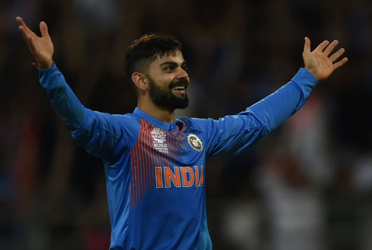 India's Virat Kohli celebrates after taking the wicket of West Indies's Johnson Charles during the World T20 men's semi-final match between India and West Indies at The Wankhede Cricket Stadium in Mumbai on March 31, 2016. / AFP / INDRANIL MUKHERJEE (Photo credit: INDRANIL MUKHERJEE/AFP/Getty Images)