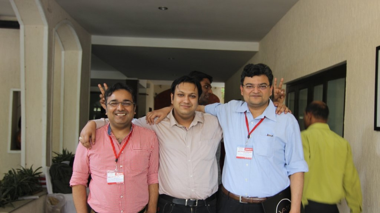 Anand Ranganathan and Rahul Roushan pose for a photograph with a participant from Bangladesh.
