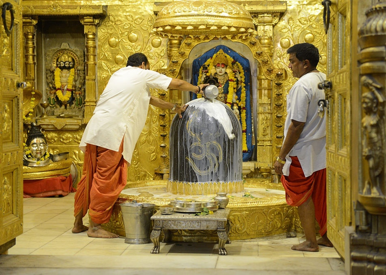 Indian Hindu priests perform religious rituals at the Somnath temple