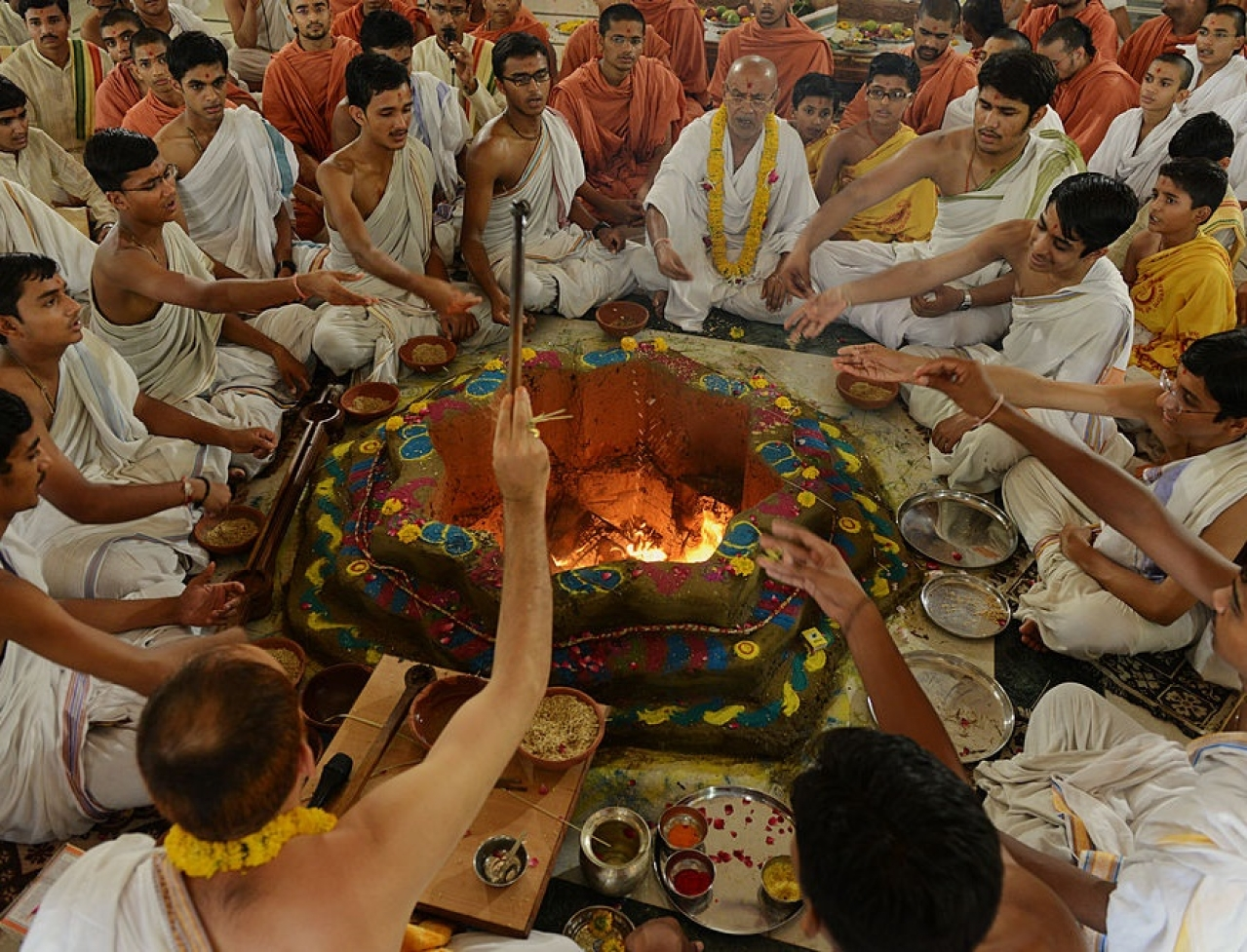Indian students and their Gurus,teachers, perform a ritual at a  Swaminarayan Gurukul Vishwavidya Pratisthanam (SGVP) temple . Getty Images