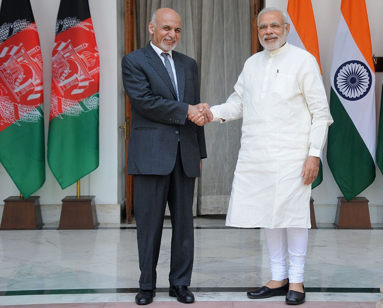 Ghani shakes hands with Modi in New Delhi. Photo credit: STRDEL/AFP/GettyImages