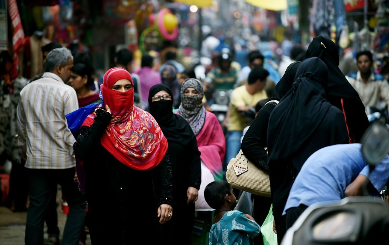 Muslim shoppers walk through a market in Bhopal. Photo credit: MONEY SHARMA/AFP/GettyImages