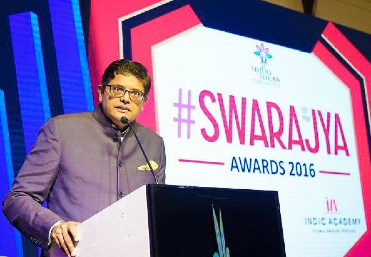 Jay Panda speaking intently at the ceremony