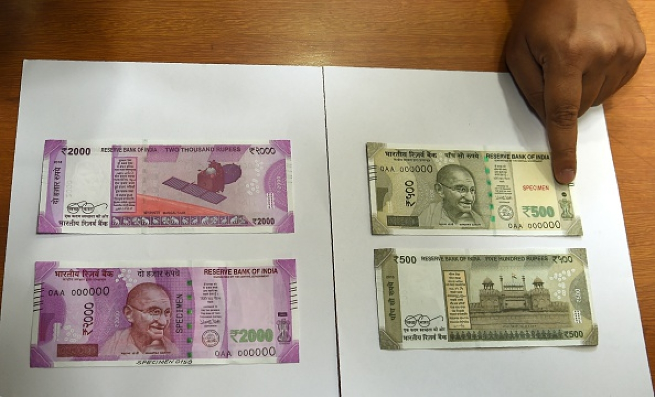 Samples of the new Rs 500 and Rs 2,000  notes are displayed at the Reserve Bank of India  headquarters in Mumbai a day after the demonetisation announcement on 8 November. Photo credit: PUNIT PARANJPE/AFP/GettyImages