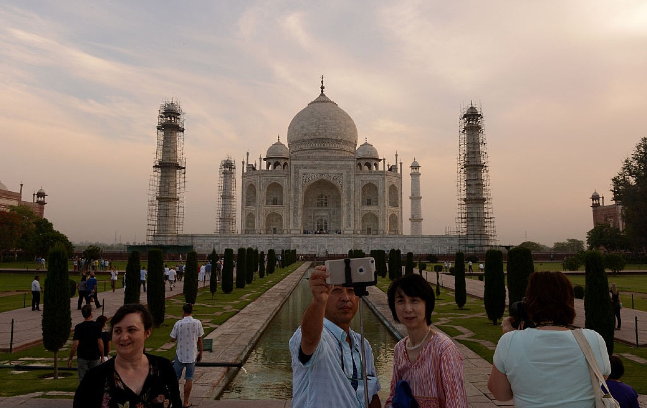 Tourists take a Selfie as they visit the Taj Mahal in Agra. (MONEY SHARMA/AFP/Getty Images)
