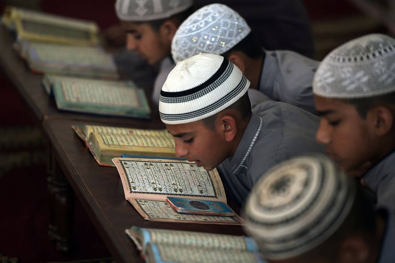 Students of a madrassa. [AAMIR QURESHI/AFP/GettyImages]
