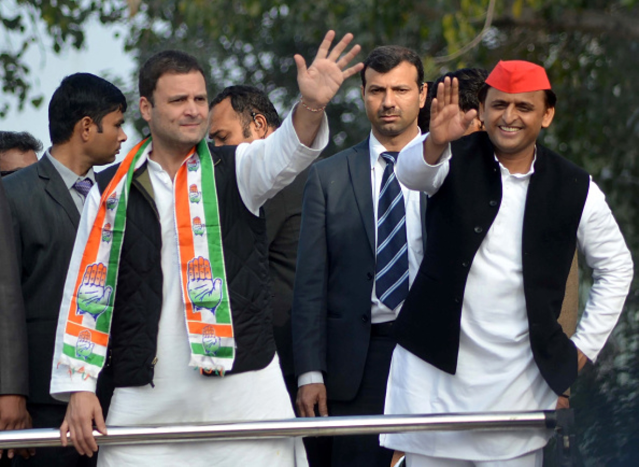 Rahul Gandhi (left) and Akhilesh Yadav wave to supporters during a joint roadshow through the streets of Lucknow. (STRINGER/AFP/Getty Images)