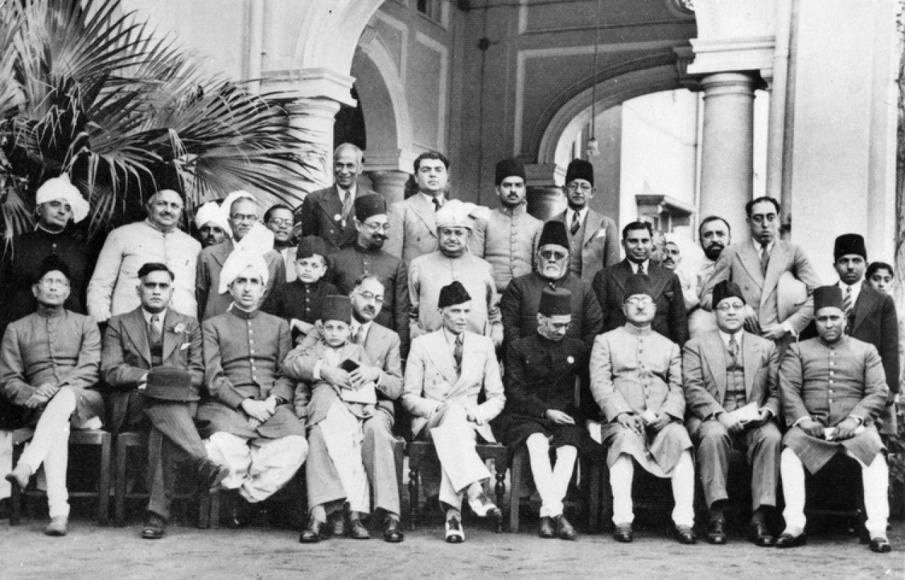 Muslim League leaders after a dinner party given at the residence of Mian Bashir Ahmad, Lahore, 1940. Group portrait with Jinnah seated in the centre. (British Library)