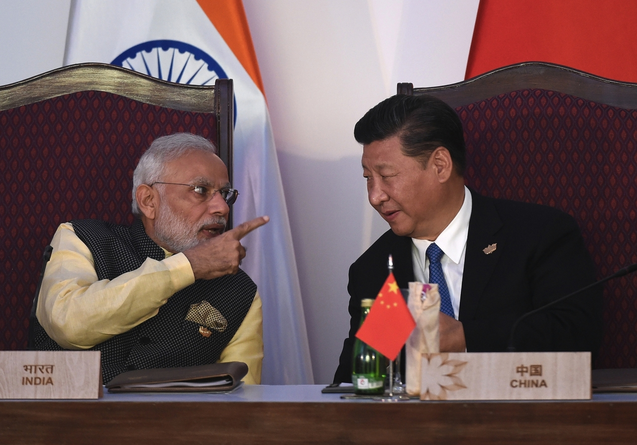 Modi and Xi Jingping (PRAKASH SINGH/AFP/Getty Images)