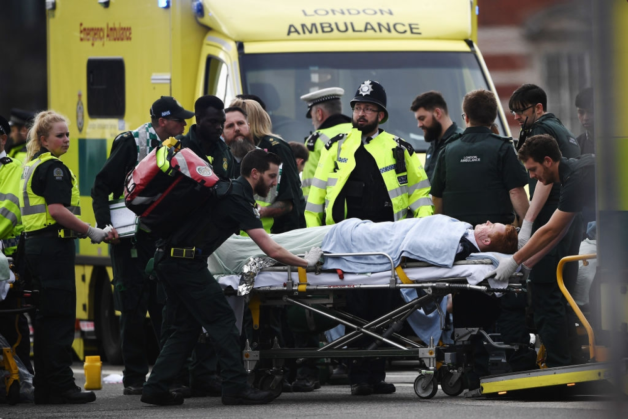 A member of the public is treated by emergency services near Westminster Bridge and the Houses of Parliament after the terror attack. (Carl Court/GettyImages)