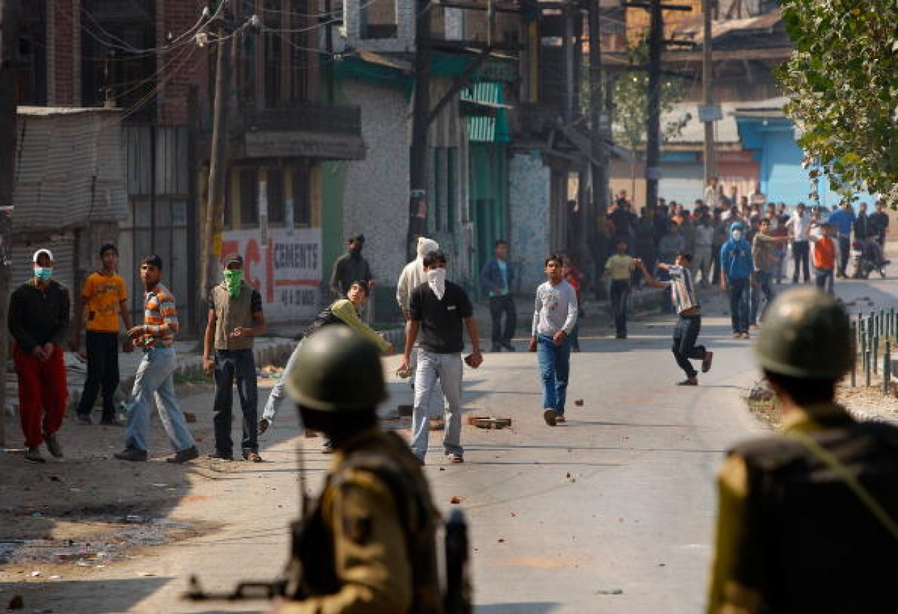 Kashmiri youth throw stones at the Indian military  in Srinagar. (Paula Bronstein/GettyImages)