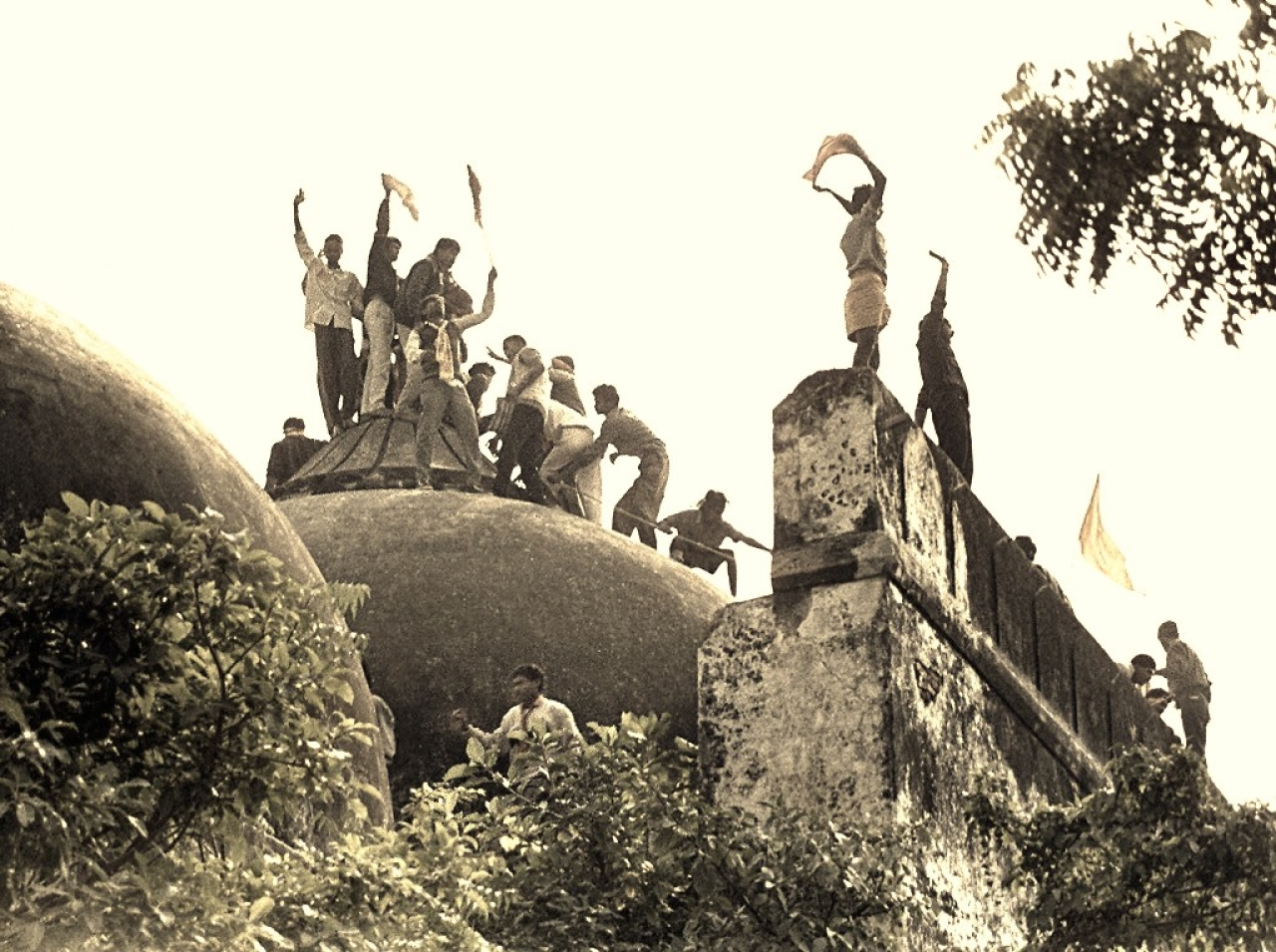 Hindu youth atop the disputed structure in Ayodhya