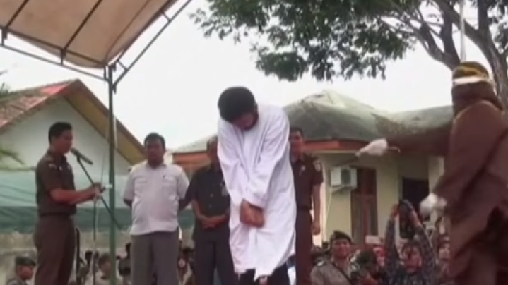 Islamic Shariah In Action: Two Gay Men Caned In Indonesia As Crowd Cheers