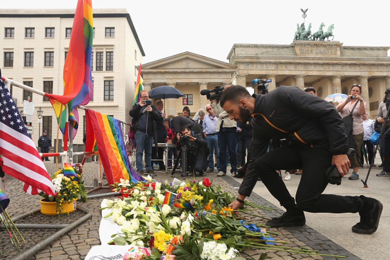 A mourner attends a vigil for victims of a shooting at a gay nightclub in Orlando, Florida, in front of the United States embassy in Berlin, Germany. (Adam Berry/Getty Images)