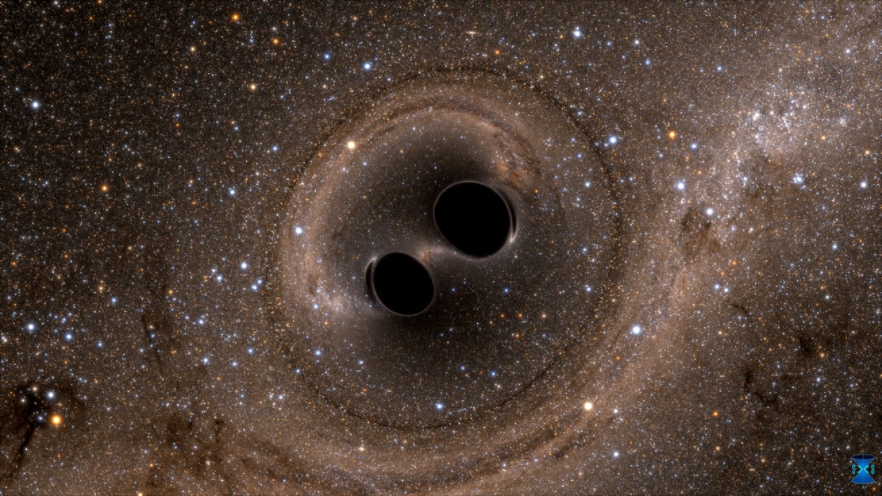 Two black holes   spiral inwards, heading towards a collision.
