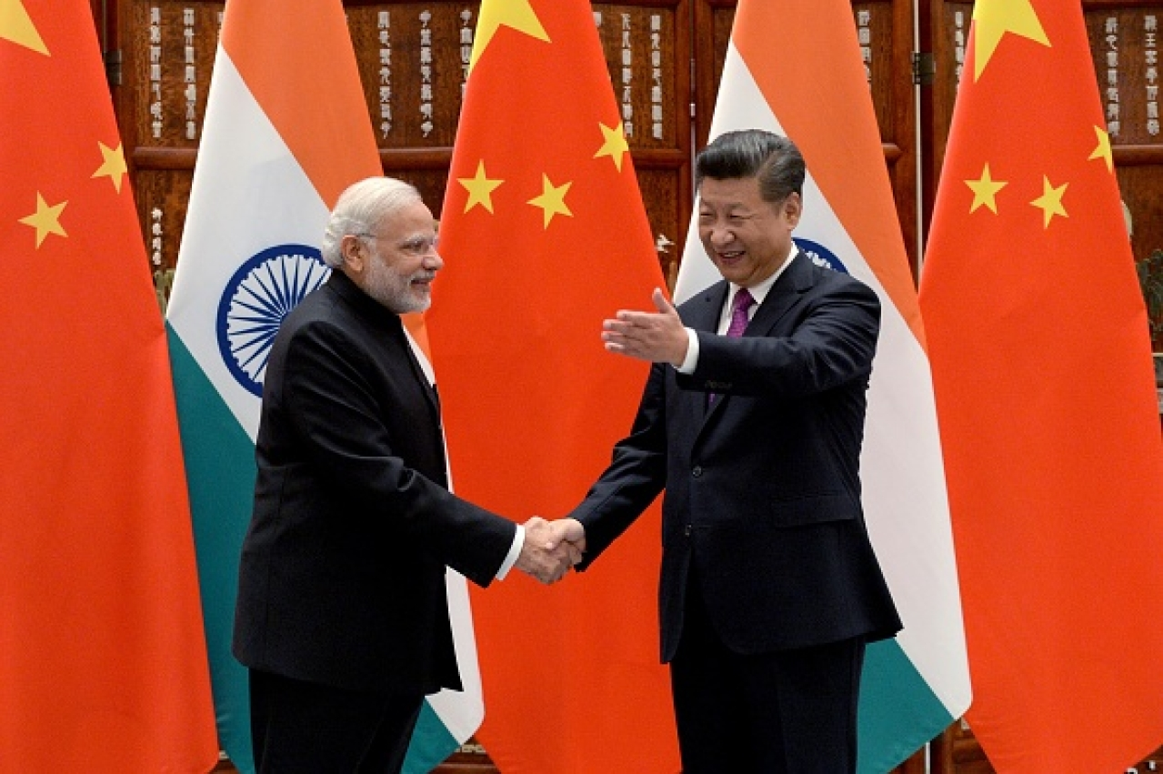 Indian Prime Minister Narendra Modi with Chinese Premier Xi Jinping (Wang Zhou - Pool/Getty Images)
