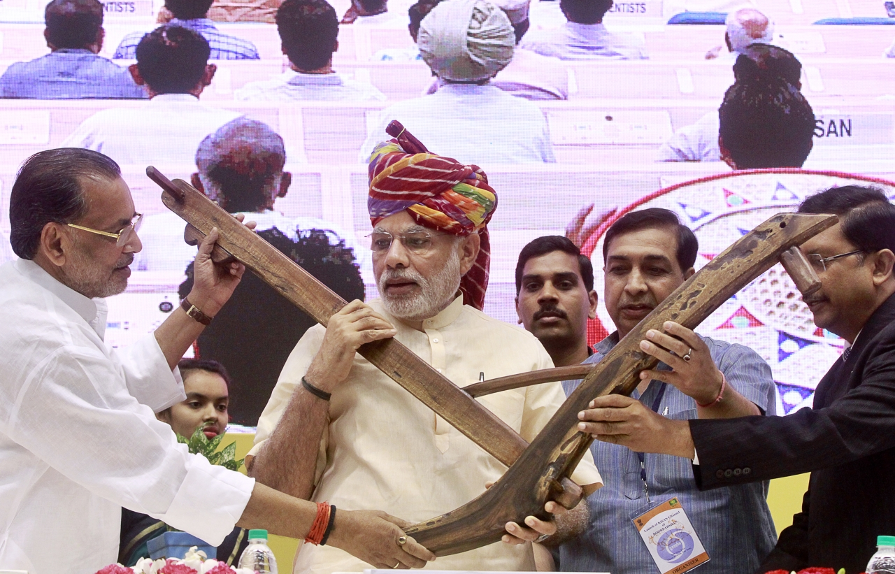 Prime Minister Narendra Modi being presented a model of plough by Agriculture Minister Radha Mohan Singh during the launch of DD Kisan Channel at a ceremony at Vigyan Bhawan on May 26, 2015 in New Delhi, India. Launching the channel for farmers on the first anniversary of his government, Modi said the agriculture sector had been neglected and there was need to make the sector vibrant. (Photo by Sanjeev Verma/Hindustan Times via Getty Images)
