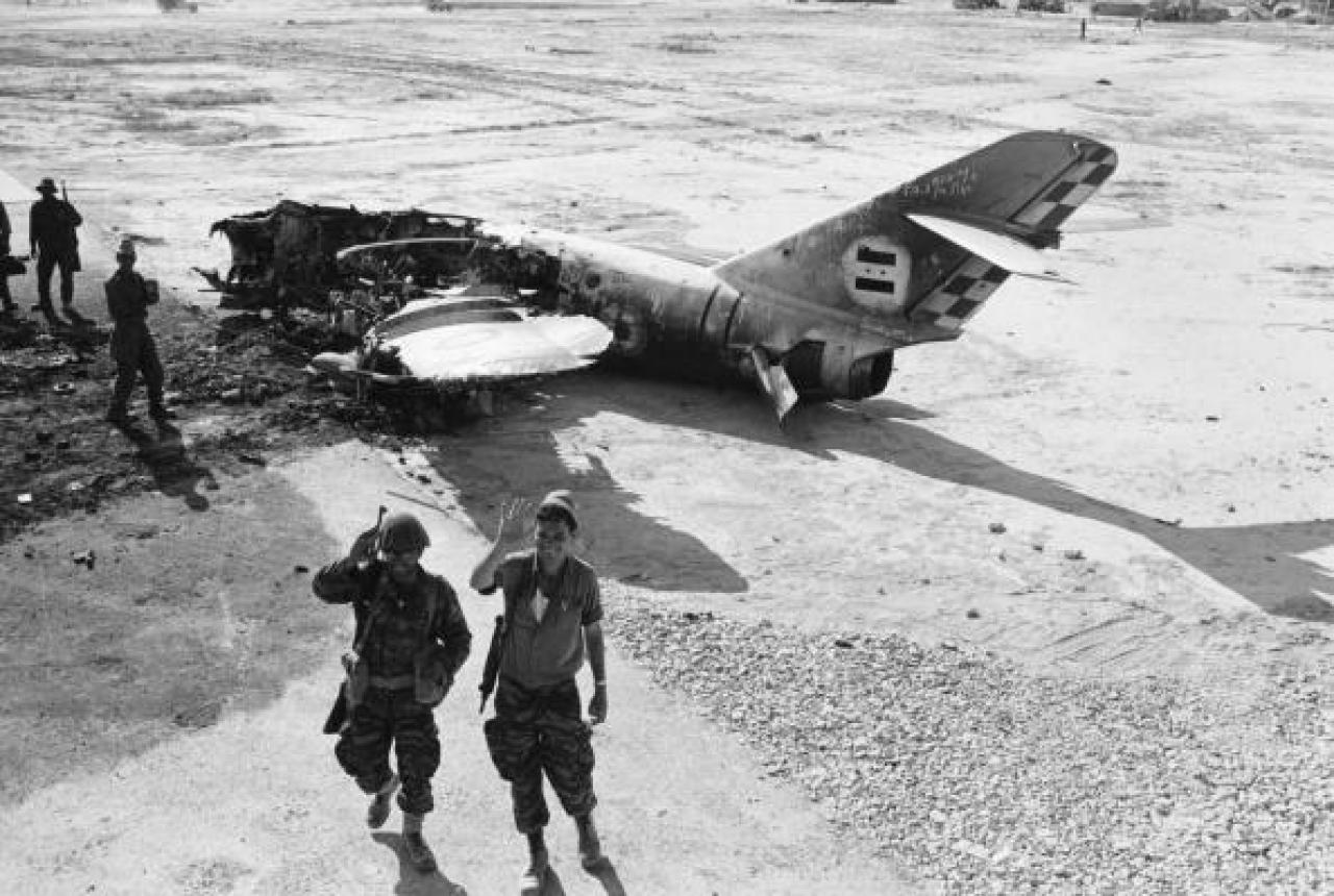 Advancing Israeli Trpthe Wreckage Of An Arab Warplane Near El Arish Airport During