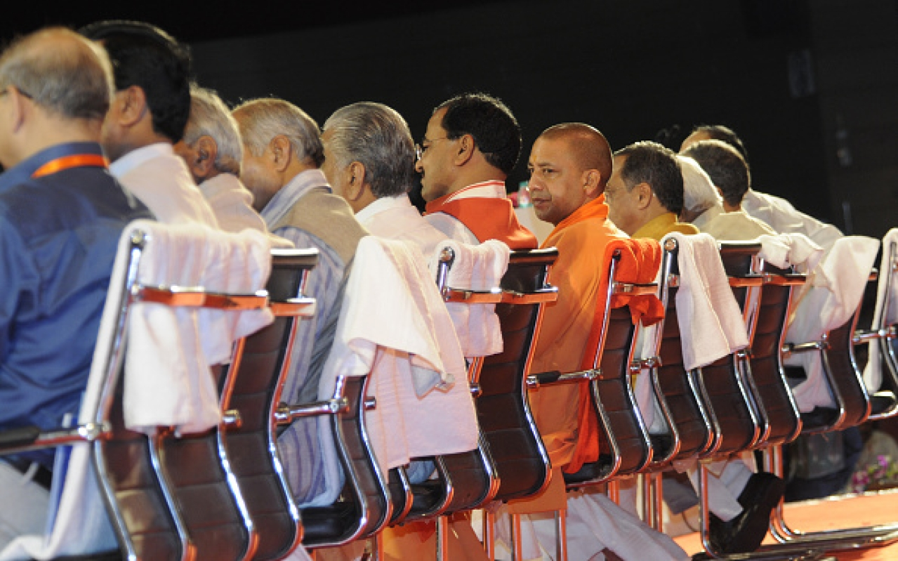 Uttar Pradesh Chief Minister Yogi Adityanath sits amid top ministers and officials at Rashtriya Panchayati Raj Diwas Programme. (Ashok Dutta/Hindustan Times via GettyImages)