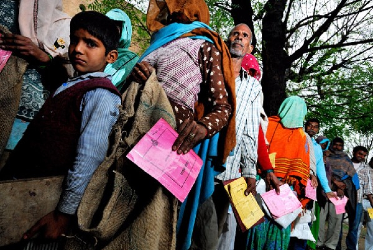People waiting to get ration from public distribution system (PDS) outlet in village Khedla in Haryana. (Priyanka Parashar/Mint via Getty Images)